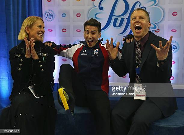 Max Aarons reacts along with his coaches Becky Calvin and Tom Zakrajsek as his score is announced in the Men's Free Skate during the 2013 Prudential...