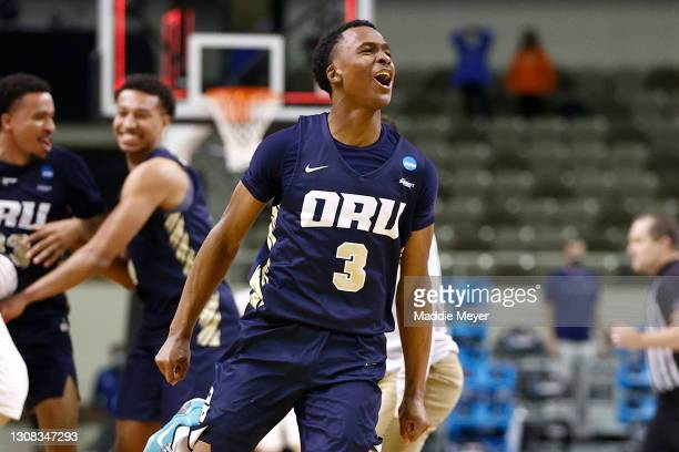 Max Abmas of the Oral Roberts Golden Eagles celebrates with teammates after defeating the Florida Gators in the second round game of the 2021 NCAA...