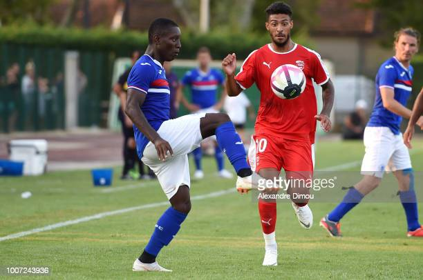 Max Alain Gradel of Toulouse and Denis Bouanga new player of Nimes during the friendly match between Nimes and Toulouse at Stade des Costieres on...