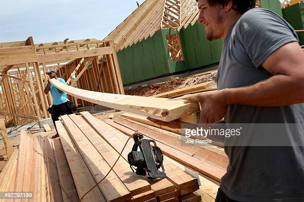Max Alvarez and Hollan Corliss work on building a new home to replace the one that was destroyed almost one year ago by a tornado on May 19 2014 in...