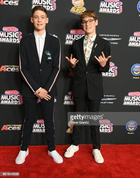 Max and Harvey arrives at the 2018 Radio Disney Music Awards at Loews Hollywood Hotel on June 22 2018 in Hollywood California