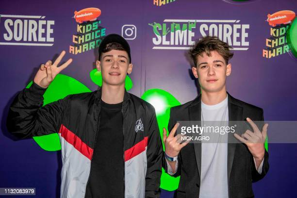 Max and Harvey Mills arrive for the Nickelodeon Kids Choice Awards Slime Soiree March 22 2019 at the Wave House in Venice California