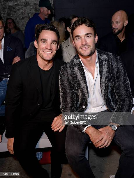 Max and Thom Evans attend the Julien Macdonald show during London Fashion Week September 2017 on September 18 2017 in London England