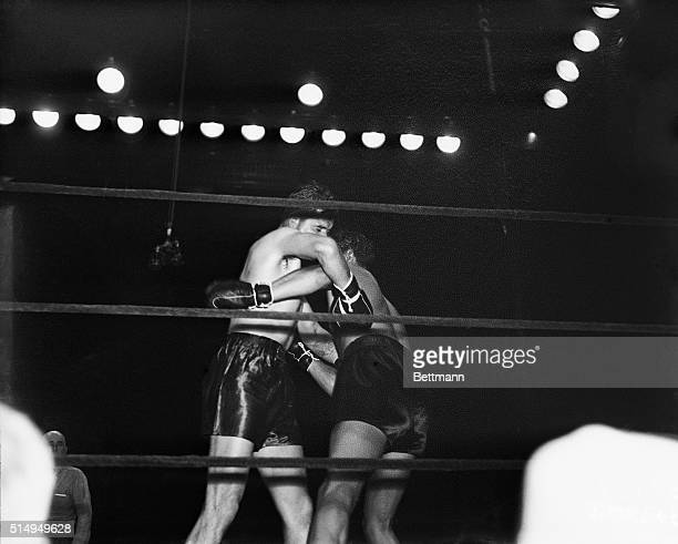 Max Baer and Jimmy Braddock clinch during the fifth round of their championship fight at Madison Square Garden June 13 1935 Braddock the 71 underdog...