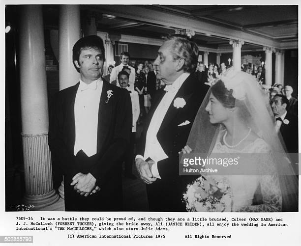 Max Baer Jr waits as Forrest Tucker gives the bride Janice Heiden away in a scene for the movie The Wild McCullochs circa 1975