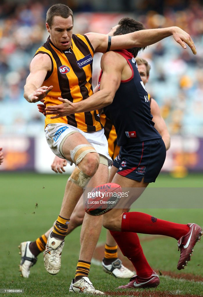 Max Bailey of the Hawks kicks the ball during the round 18 AFL match between the Melbourne Demons and the Hawthorn Hawks at Melbourne Cricket Ground on July 24, 2011 in Melbourne, Australia.
