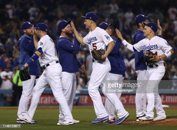Max Beaty AJ Pollock Alex Verdugo Corey Seager Kenta Maeda Rich Hill and Enrique Hernandez of the Los Angeles Dodgers celebrate after their MLB game...