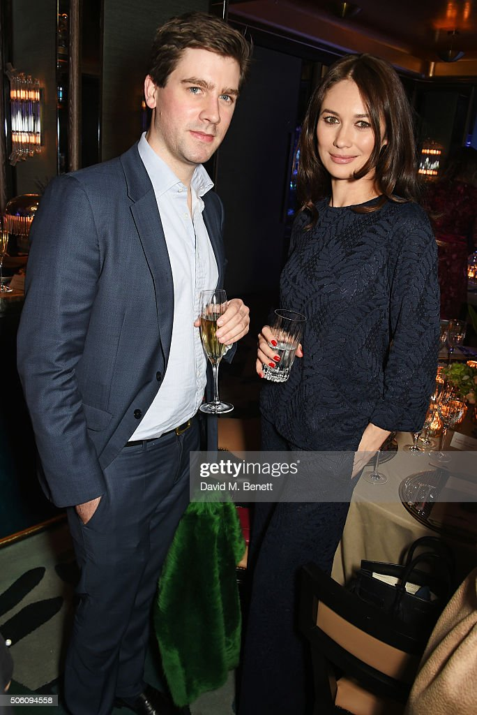 Max Benitz (L) and Olga Kurylenko attend a private dinner hosted by Creme de la Mer to celebrate the launch of Genaissance de la Mer the Serum Essence, available exclusively at Harrods, at Sexy Fish on January 21, 2016 in London, England.