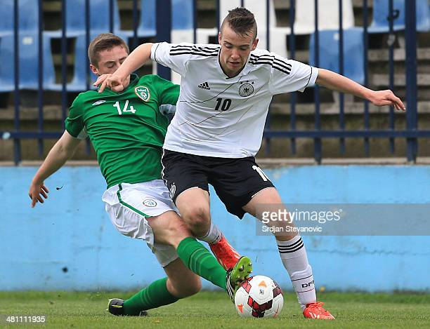 Max Besuschkow is challenged by Anthony Dolan of Ireland during the UEFA Under17 Elite Round between Germany and Ireland at Stadion FC Obilic on...