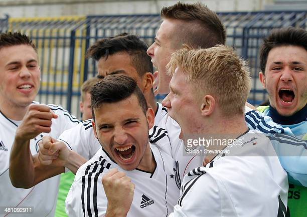 Max Besuschkow of Germany celebrate his goal with Arianit Ferati and Phillipp Ochs during the UEFA Under17 Elite Round between Germany and Ireland at...