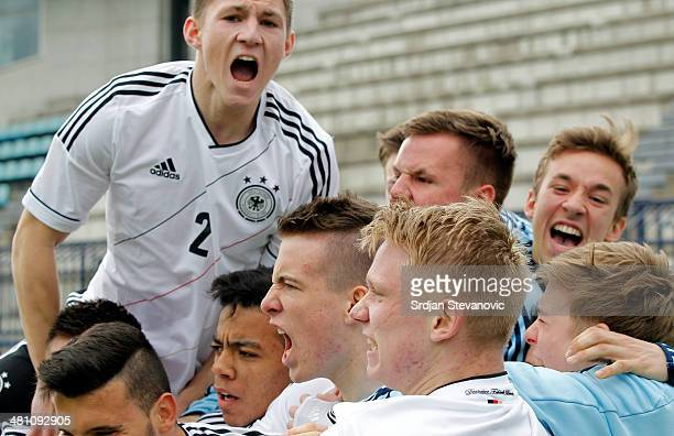 Max Besuschkow of Germany celebrate his goal with team mates during the UEFA Under17 Elite Round between Germany and Ireland at Stadion FC Obilic on...