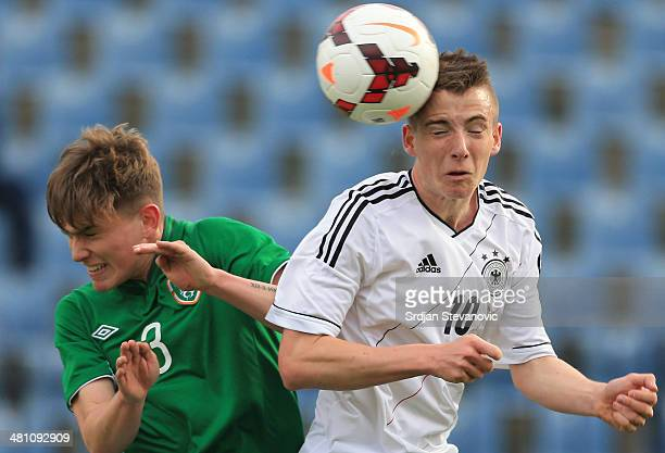 Max Besuschkow of Germany jump for the ball with Anthony Breslin of Ireland during the UEFA Under17 Elite Round between Germany and Ireland at...