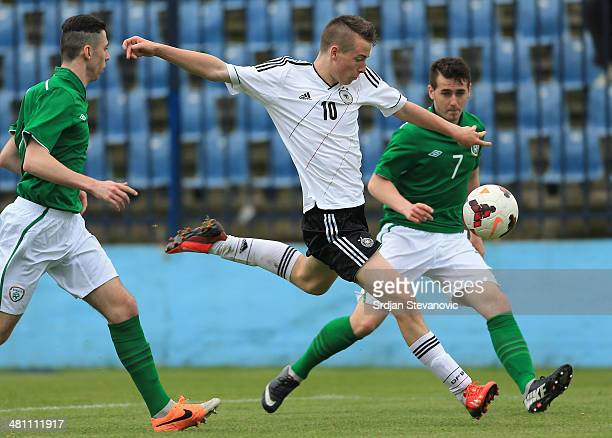 Max Besuschkow shoot the ball near Shane Elworthy of Ireland during the UEFA Under17 Elite Round between Germany and Ireland at Stadion FC Obilic on...