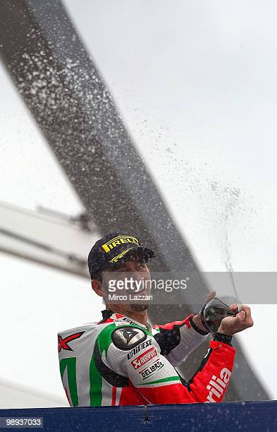 Max Biaggi of Italy and Aprilia Alitalia Racing celebrates on the podium the victory at the end of the Race Two of the Supersbike World Championship...