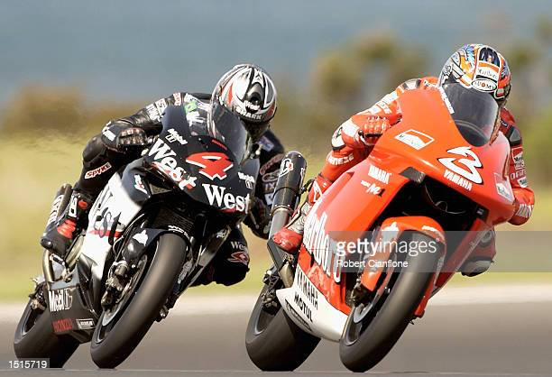 Max Biaggi of Italy and the Marlboro Yamaha Team is closely followed by Loris Capirossi of Italy and the West Honda Pons Team during free practice...