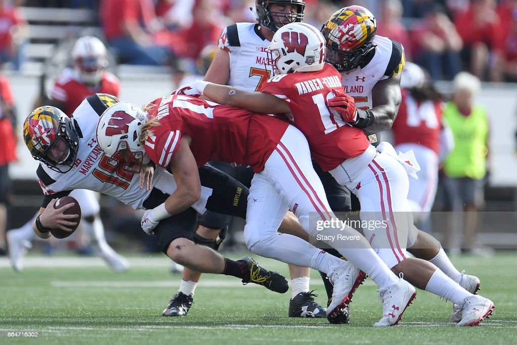 Max Bortenschlager #18 of the Maryland Terrapins is sacked by Andrew Van Ginkel #17 of the Wisconsin Badgers during a game at Camp Randall Stadium on October 21, 2017 in Madison, Wisconsin.