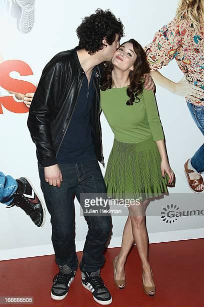 Max Boublil and Melanie Bernier attend 'Les Gamins' Paris Premiere at Cinema Gaumont Capucine on April 15 2013 in Paris France
