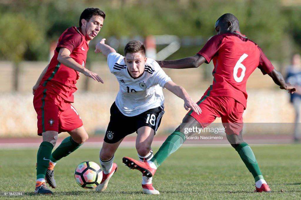 Max Brandt (C) of Germany U17 challenges Francisco Saldanha (L) and Henrique Jocu (R) of Portugal U17 during U17-Juniors Algarve Cup match between U17 Portugal and U17 Germany at Bela Vista Stadium on February 13, 2018 in Parchal, Portugal.