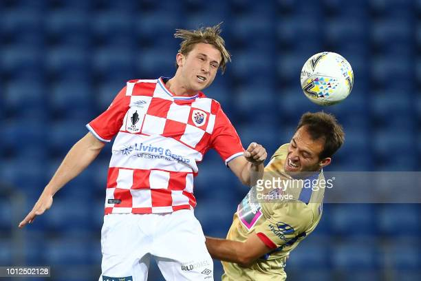 Max Brown of the Knights heads the ball during the FFA Cup round of 32 match between Gold Coast Knights and Newcastle Jets at Cbus Stadium on August...