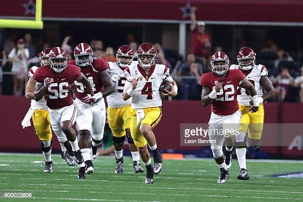 Max Browne of the USC Trojans carries the ball against Tim Williams of the Alabama Crimson Tide Dalvin Tomlinson of the Alabama Crimson Tide and Ryan...