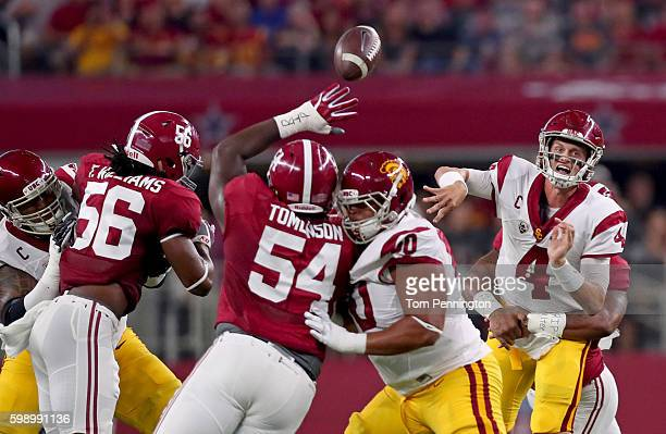 Max Browne of the USC Trojans is pressured by the Alabama Crimson Tide defense including Dalvin Tomlinson and Tim Williams in the first quarter...