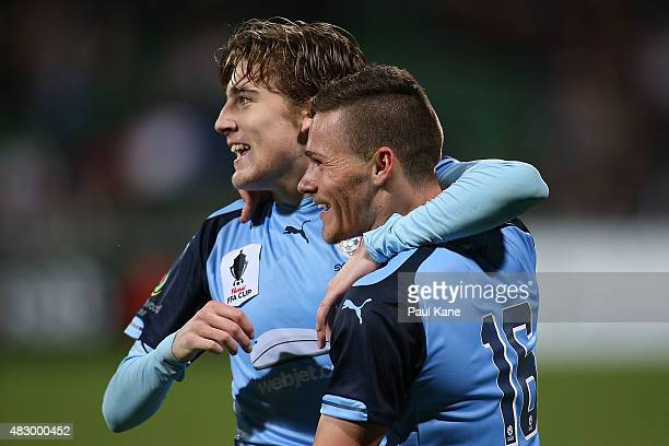 Max Burgess of Sydney is congratulated by Riley Woodcock after scoring a goal during the FFA Cup match between Sorrento FC and Sydney FC at nib...