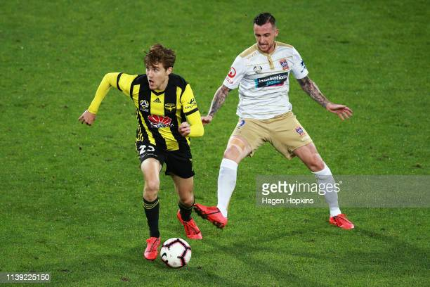 Max Burgess of the Phoenix is challenged by Roy O'Donovan of the Jets during the round 23 ALeague match between the Wellington Phoenix and Newcastle...