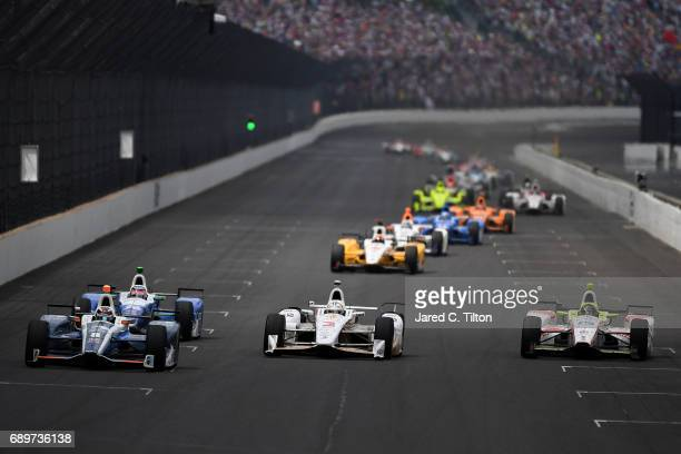 Max Chilton of England driver of the Gallagher Honda Helio Castroneves of Brazil driver of the Shell Fuel Rewards Team Penske Chevrolet and Ed Jones...