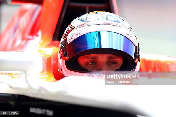 Max Chilton of Great Britain and Marussia sits in his car in the garage during day two of testing at Silverstone Circuit on July 9 2014 in...