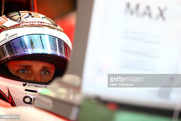Max Chilton of Great Britain and Marussia sits in his car in the garage during practice ahead of the Russian Formula One Grand Prix at Sochi Autodrom...