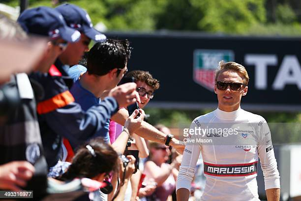 Max Chilton of Great Britain and Marussia walks along the pit lane ahead of the Monaco Formula One Grand Prix at Circuit de Monaco on May 23 2014 in...