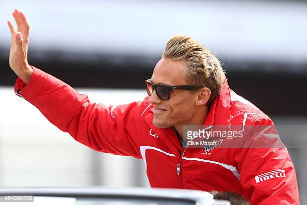 Max Chilton of Great Britain and Marussia waves to the crowd during the drivers' parade before the Belgian Grand Prix at Circuit de SpaFrancorchamps...