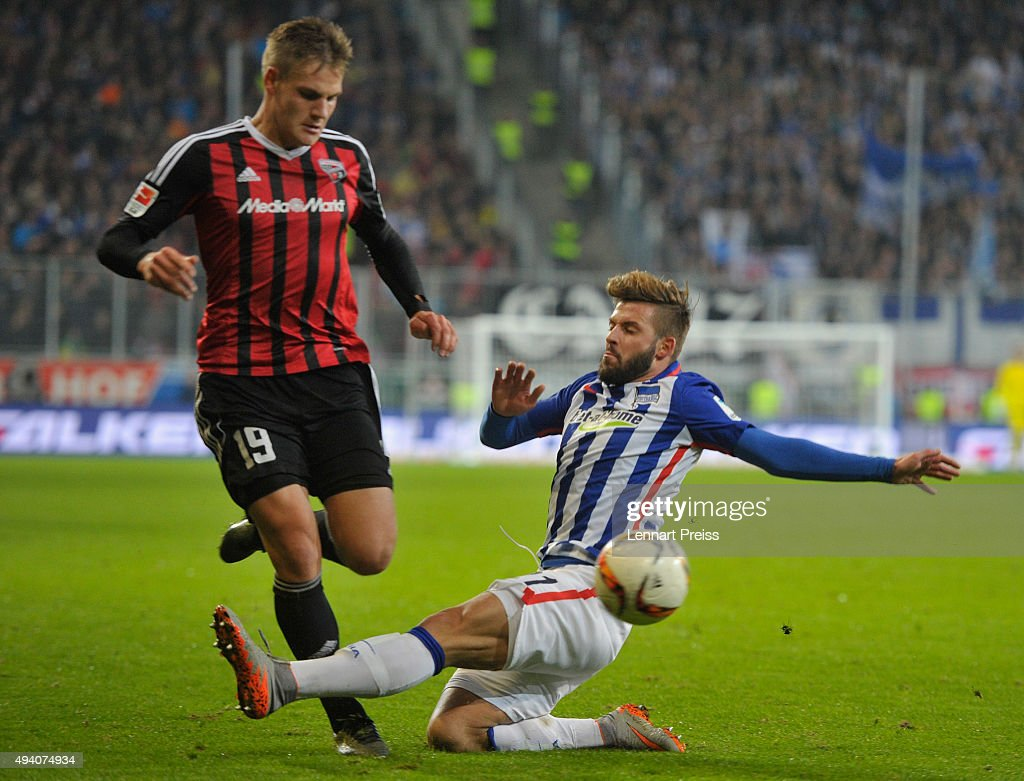 Max Christiansen (L) of FC Ingolstadt challenges Marvin Plattenhardt of Hertha BSC during the Bundesliga match between FC Ingolstadt and Hertha BSC at Audi Sportpark on October 24, 2015 in Ingolstadt, Germany.