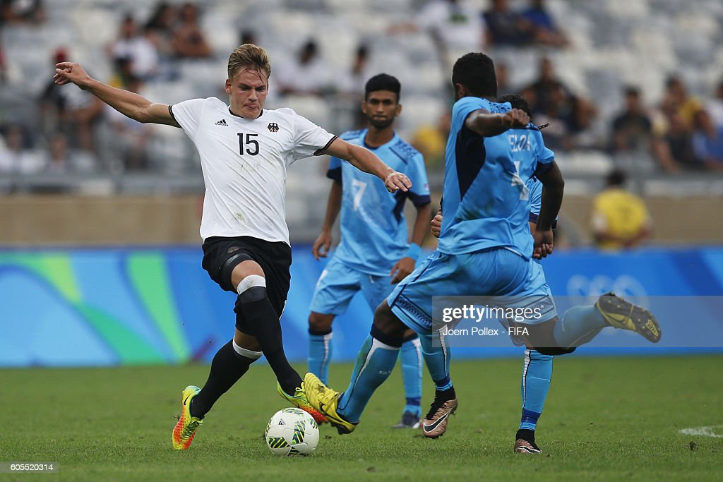 Max Christiansen (L) of Germany and Jale Dreloa of Fiji compete for the ball during the Men's Group C match between Germany and Fiji on Day 5 of the Rio2016 Olympic Games at Mineirao Stadium on August 10, 2016 in Belo Horizonte, Brazil.