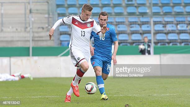 Max Christiansen of Germany challenges Juraj Chvatal of Slovakia during the UEFA Under19 Elite Round match between U19 Germany and U19 Slovakia at...