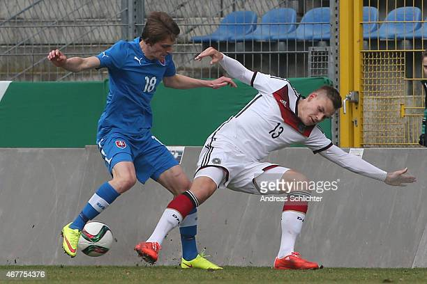Max Christiansen of Germany challenges Robert Polievka of Slovakia during the UEFA Under19 Elite Round match between U19 Germany and U19 Slovakia at...