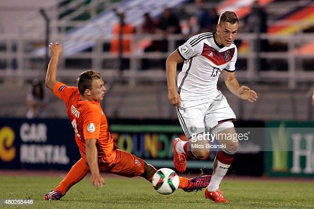 Max Christiansen of Germany competes with Frankie De Jong of Netherlands during the UEFA U19 Championship 2015 final tournament match between...