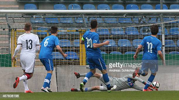 Max Christiansen of Germany scores the first goal past Keeper Marek Rodak of Slovakia during the UEFA Under19 Elite Round match between U19 Germany...