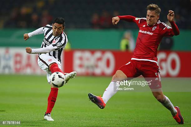 Max Christiansen of Ingolstadt blocks a shot from Marco Fabian of Frankfurt during the DFB Cup Second Round match between Eintracht Frankfurt and FC...