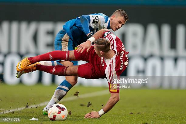 Max Christiansen of Rostock and Manuel Schaeffler of Kiel compete during the Third League match between Hansa Rostock and Holstein Kiel at DKBArena...
