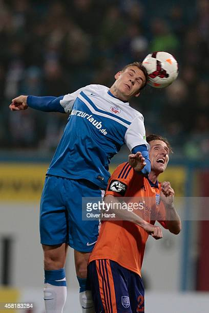 Max Christiansen of Rostock and Michael Hohnstedt of Osnabrueck compete for the ball between the 3 Liga Hansa Rostock and VfL Osnabrueck during the...