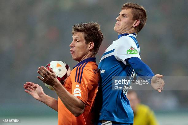 Max Christiansen of Rostock and Nicolas Feldhahn of Osnabrueck compete for the ball between the 3 Liga Hansa Rostock and VfL Osnabrueck during the at...