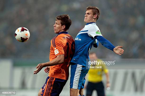 Max Christiansen of Rostock and Nicolas Feldhahn of Osnabrueck compete for the ball between the 3 Liga Hansa Rostock and VfL Osnabrueck at DKBArena...