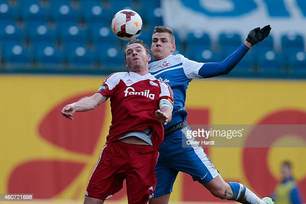 Max Christiansen of Rostock and Rafael Kazior of Kiel compete during the Third League match between Hansa Rostock and Holstein Kiel at DKBArena on...