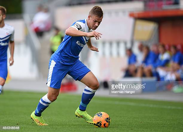 Max Christiansen of Rostock controls the ball during the Third league match between 1 FSV Mainz 05 II and Hansa Rostock at Bruchweg Stadium on August...