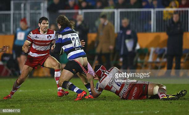 Max Clark of Bath is tackled by Sione Kalamafoni of Gloucester as James Hook closes in during the Anglo Welsh Cup match between Bath Rugby and...