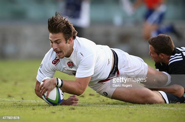 Max Clark of England dives over for the first try during the World Rugby U20 Championship final match between England and New Zealand at Stadio...