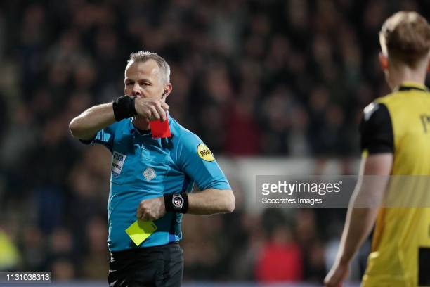 Max Clark of Vitesse receives the second yellow and red card from referee Bjorn Kuipers during the Dutch Eredivisie match between Heracles Almelo v...