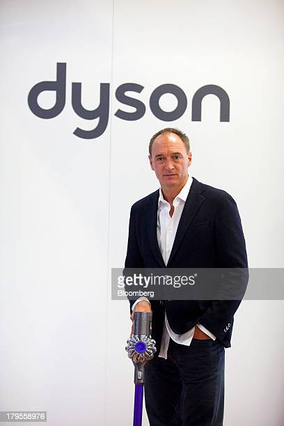 Max Conze chief executive officer of Dyson Ltd poses for a photograph with a Dyson Cinetic DC 52 Animal Complete vacuum cleaner following a Bloomberg...