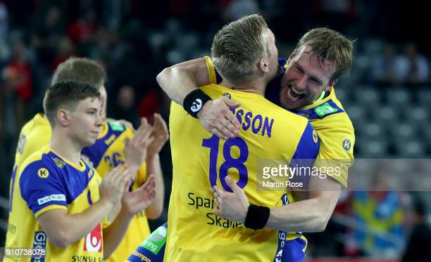 Max Darj of Sweden celebrate with team mate Frederic Pettersson after the Men's Handball European Championship semi final match between Denmark and...